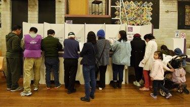 People cast their vote at Cabramatta Public School polling station, Cabramatta.