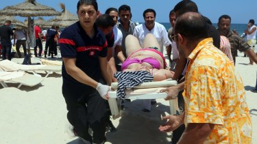 Tunisian medics carry a woman on a stretcher in the resort town of Sousse.