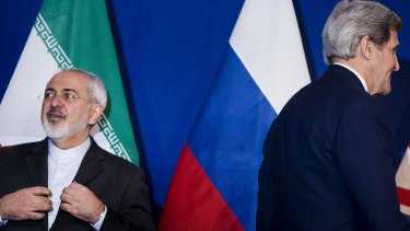Iranian Foreign Minister Javad Zarif (left) waits to make a statement next to US Secretary of State John Kerry (right), following nuclear talks in Lausanne.
