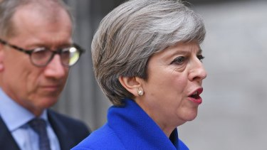 In distress: British Prime Minister Theresa May.