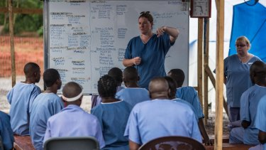 Amanda McClelland working in an Ebola affected area in a Red Cross field hospital in Kenema, Sierra Leone.