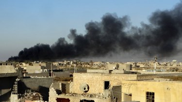 Smoke rises from Islamic State positions following a US-led coalition airstrike on Saturday.