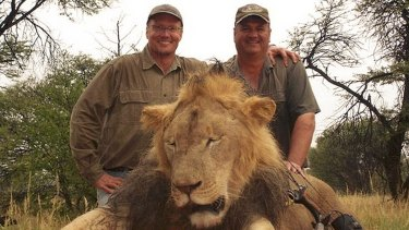 Walter Palmer (left) poses with the corpse of Cecil the lion after hunting him with his bow, wounding the leader of the pride, and shooting him 40 hours later.