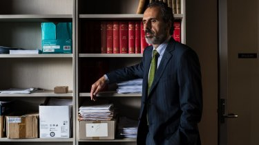 John Azzi, who has represented gay asylum seekers in court, in his office at the University of Western Sydney.