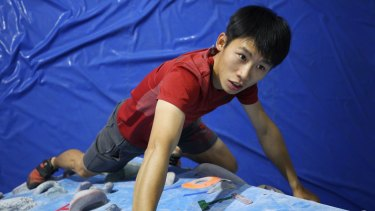 Australian university graduate Jacky Wan, now working at Beijing outdoor company Summit Experience