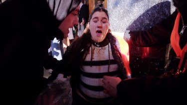 An anti-racism protester Kat Galea is cared for after being pepper sprayed.