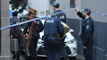 Police officers arriving at a crime scene in Surry Hills on Monday, July 30.