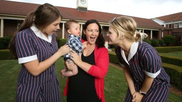 School teacher Amy Payten and her baby son James meeting her year 12  students   Olivia Whiting and Kirsten Hargreaves.