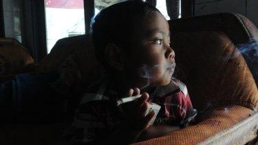 Muhammad Dihan Awalidan, 4, is part of Indonesia's smoking epidemic.
