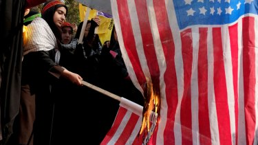Burning the US flag to mark the 34th anniversary of the 1979 US embassy takeover in Tehran in 2013.