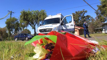 Floral tributes at the scene of the Lalor Park murders.