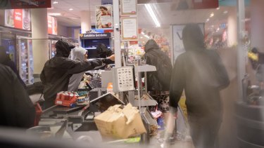 Anarchists ransack a supermarket as part of G20 protests.