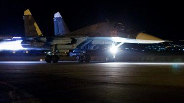 A Russian Su-34 bomber takes off on a night combat mission from Hemeimeem airbase in Syria.