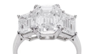 A three-stone diamond ring.