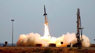 "The University of Queensland's ""HyShot"", a hypersonic ""scramjet"", blasts off from its launch pad at Woomera."