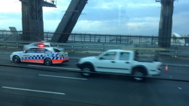 Police and emergency services vehicles on the Sydney Harbour Bridge following the crash this morning.