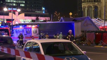 Emergency services attend the scene, after a truck ran into crowds at a Christmas market in Berlin.
