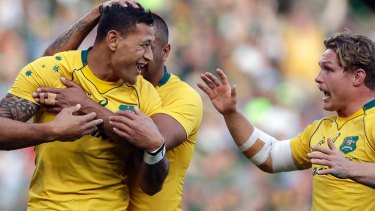 Mobbed: Israel Folau is congratulated by Kurtley Beale and Michael Hooper after scoring against South Africa.