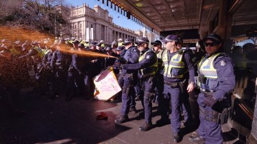 Police used pepper spray at the Melbourne protest.