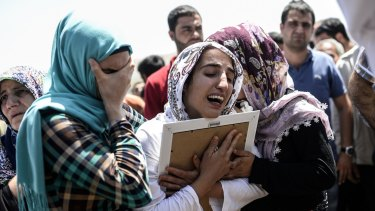 Relatives of 17-year-old victim Ramazan Yildiz mourn at his funeral.