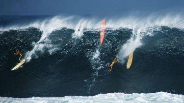 Greg Noll surfing Waimea in 1960.