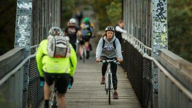 Cyclists on the bridge at Walmer Street.