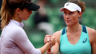Samantha Stosur shakes hands with Tsvetana Pironkova following her victory.