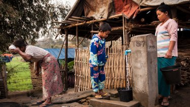 Aung Din, 12, displaced from Mung Ding Pa, collects water every morning for his household at the Phan Khar Kone camp in Bhamo city, Kachin State, Myanmar.