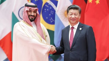 Among the powerful: Chinese President Xi Jinping (right) shakes hands with Saudi Arabian Deputy Crown Prince Mohammed bin Salman.