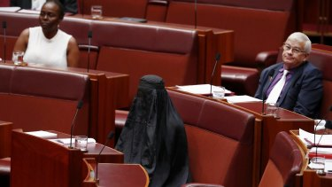 One Nation senator Pauline Hanson wearing a burqa during Question Time at Parliament House in Canberra in August.