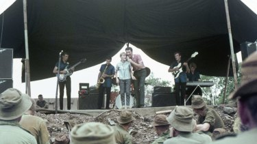 Little Pattie on stage with Col Joye and the Joye Boys at Nui Dat, Vietnam, 1966