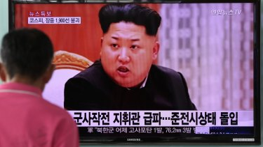 A man looks at a television screen showing an image of Kim Jong-un, leader of North Korea, in Seoul, South Korea.