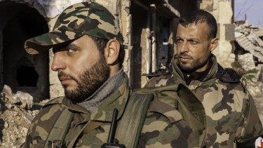 SSNP militiamen Yousef Khalaf (left) and Ibrahim al-Khalil patrol Homs.