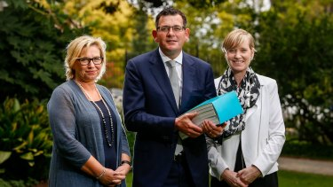 Rosie Batty, Premier Daniel Andrews, and Fiona Richardson, Minister for the Prevention of Family Violence, at the release of the report by the Royal Commission into Family Violence at Parliament House on March 30.