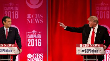 Donald Trump gestures towards Senator Ted Cruz.
