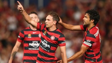 Double: Brendon Santalab of the Wanderers celebrates scoring.