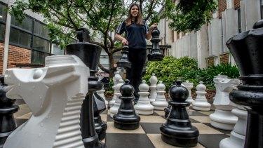 Saffron, 13, plays chess to challenge herself mentally.