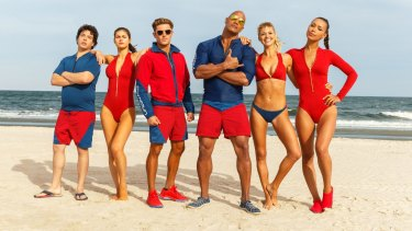 The  Baywatch  cast (from left): Jon Bass as Ronnie, Alex Daddario as Summer, Zac Efron as Matt Brody, Dwayne Johnson as Mitch Buchannon, Kelly Rohrbach as C.J. Parker and Ilfenesh Hadera as Stephanie Holden.