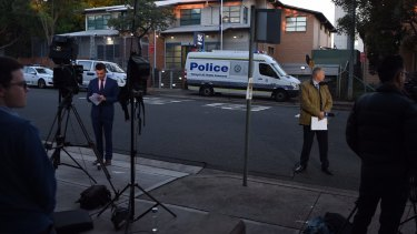 The media gather outside Merrylands Police Station on Friday morning.