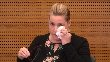 Jacqueline McDowall fights back tears in the witness box.
