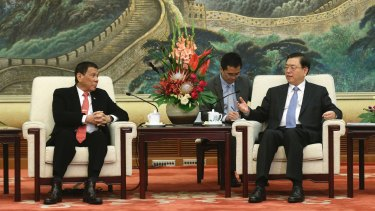 """Philippines President Rodrigo Duterte, seen here in Beijing (left), has caused regional concern by """"separating"""" from the US to start talks with Beijing."""