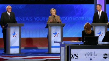 Hillary Clinton speaks between Bernie Sanders and former Maryland governor Martin O'Malley during the debate hosted by ABC News.