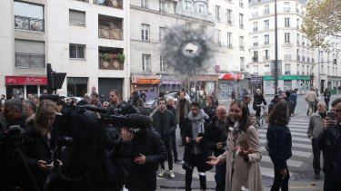 Stray bullets hit buildings adjacent to the La Belle Equipe cafe in Paris.