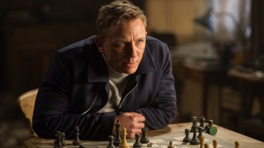 You're singing about ... feelings? Daniel Craig in a still from <i>Spectre</i>.