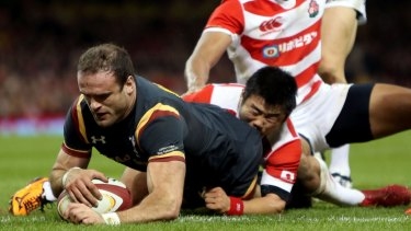 Wales' Jamie Roberts scores a try.