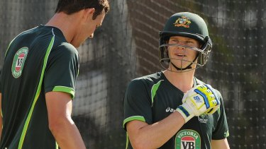 Man of the moment: Smith trains in the nets with fast bowler Josh Hazelwood on Monday.