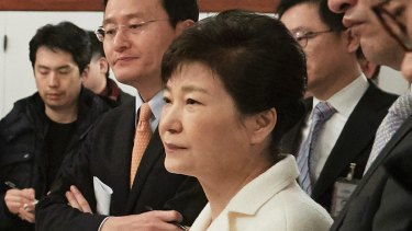 Impeached South Korean President Park Geun-hye listens to a reporter's question during a meeting with a selected group of reporters in January. 1, 2017.