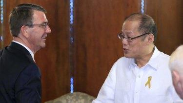 Philippine President Benigno Aquino III, right, shakes hands with US Defence Secretary Ash Carter last week.