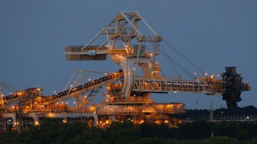 Coal-loading machinery rises above the Hunter River at Kooragang Island, Newcastle.