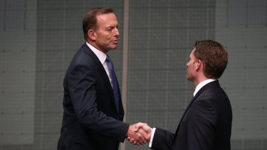 Mr Hastie is congratulated by former prime minister Tony Abbott.